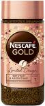 Кофе молотый в растворимом Nescafe Gold 95г